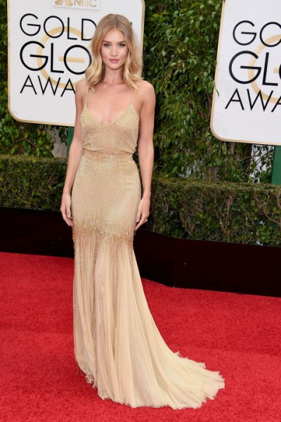 Rosie Huntington-Whiteley Atelier Versace, complimented with Jimmy Choo sandals and clutch.